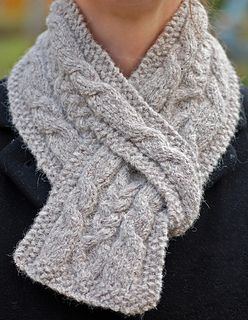 """The Hiawatha Pull-Through Cable Scarf is a uniquely designed scarf. This quick knit is a classic style with an engaging cable pattern. The pull-through design takes the guess work out of wrapping your scarf and keeps the """"right-side"""" of your cable design facing outward, where you want it!"""