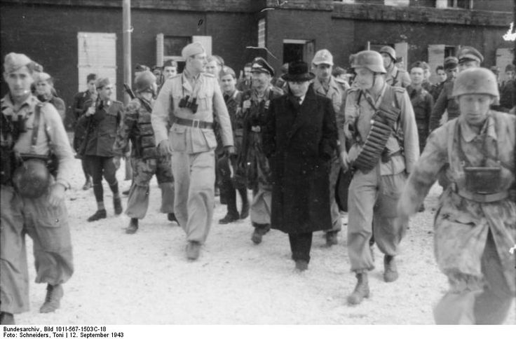 Otto Skorzeny escorting Benito Mussolini to the aircraft which would extricate him from the Hotel Campo Imperatore in Gran Sasso, Italy, 12 Sep 1943