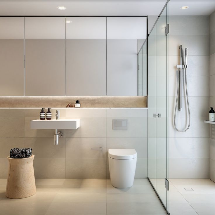 Ultra sleek and contemporary bathroom with ample face level storage behind mirrored doors, open recessed shelf and even hidden storage behind tiles. Love the high end fixtures and clean lines of this bathroom.