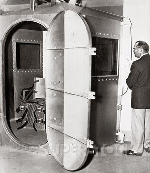 Mature man standing near a gas chamber, State Prison, Jefferson City, Missouri, USA, 1953