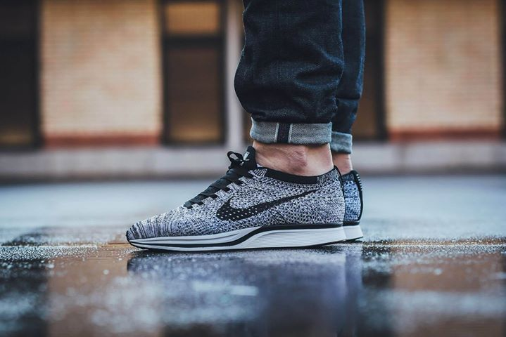 On foot shots of the Nike Flyknit Racer Black White Volt. Available now. http://ift.tt/1PlTkmi