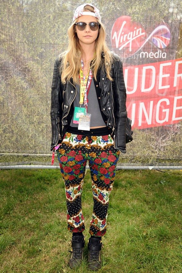 Cara Delevingne in MinkPink trousers and a Burberry leather jacket.