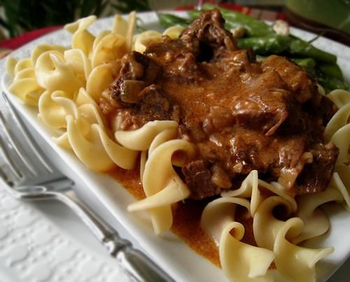 Easy Hungarian Goulash from Food.com: This is a traditional Hungarian beef dish served over buttered noodles for a hearty, satisfying meal. The amounts of garlic, onions, and especially paprika may seem excessive, but they all melt into an incredibly rich and flavorful pan gravy during the slow cooking process. The sauce is further enriched by the addition of sour cream. (Have not made yet.)
