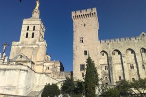 The Palais des Papes, also known as the Papal Palace, is a fortress that dominates Avignon's skyline. Discover the storied history of the building during a Provence vacation.