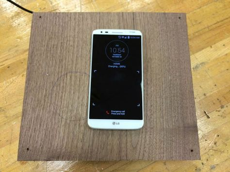 Build a hidden Qi wireless phone charger!