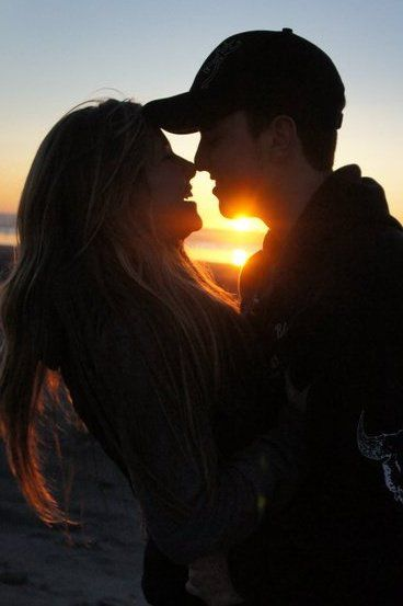Kissing on the beach at sunset <3