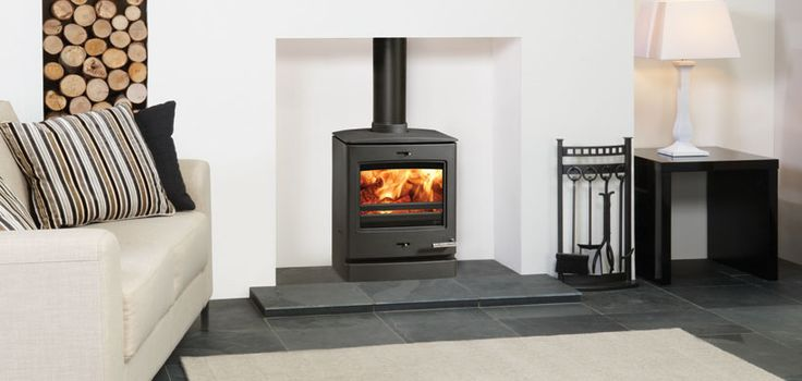 Yeoman CL5 Wood & Multi-fuel Stoves. Framed by the clean linear design of the heavy duty steel firebox, the alluring flames and enticingly glowing ember bed are both impressive and welcoming. Love this!!
