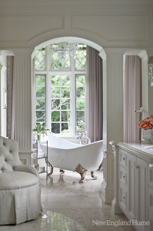 The free standing tub sits in a niche overlooking the grounds.