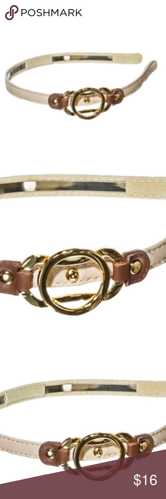 Ivory, Brown, and Gold Headband This high quality eye catching eco-friendly vegan leather .5 inch ivory colored metal headband with off centered brown buckle connecting three gold toned ring design is the perfect compliment to any outfit. Stays snugly in place without the use of hair pulling teeth on the headbands underside. Comfortable and stylish. Science by Nature Accessories Hair Accessories