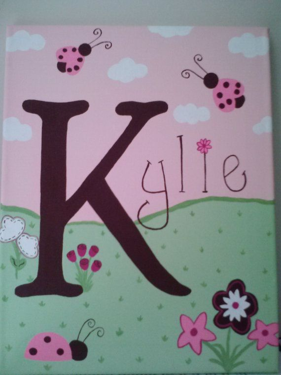 Hand Painted Name Canvas with Ladybug and Flower Theme via Etsy