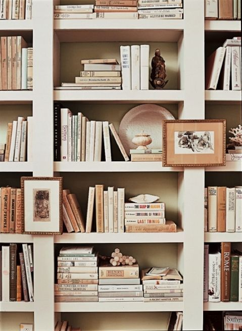Books, art and sentimental pieces pack a punch in this pretty bookcase.  Laurel Bern