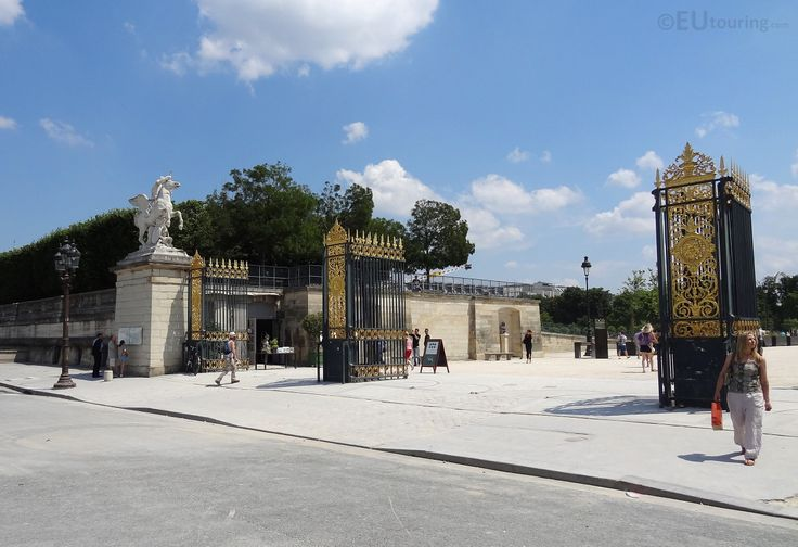 Here you can see the wrought iron gates with gilded parts which lead to the Tuilleries Gardens, as well as one of the statues of a horse which sits beside the entrance, as seen from the Place de la Concorde in Paris.  You may also like www.eutouring.com