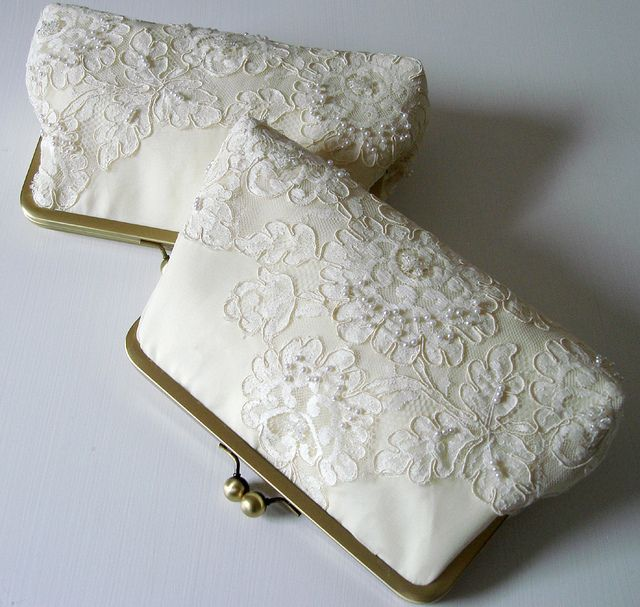 A bride's kisslock frame clutch made from a mother's wedding dress from years ago. She had one made for her daughter who is getting married this May and one for her granddaughter on her own wedding day.  It was such a sweet idea!