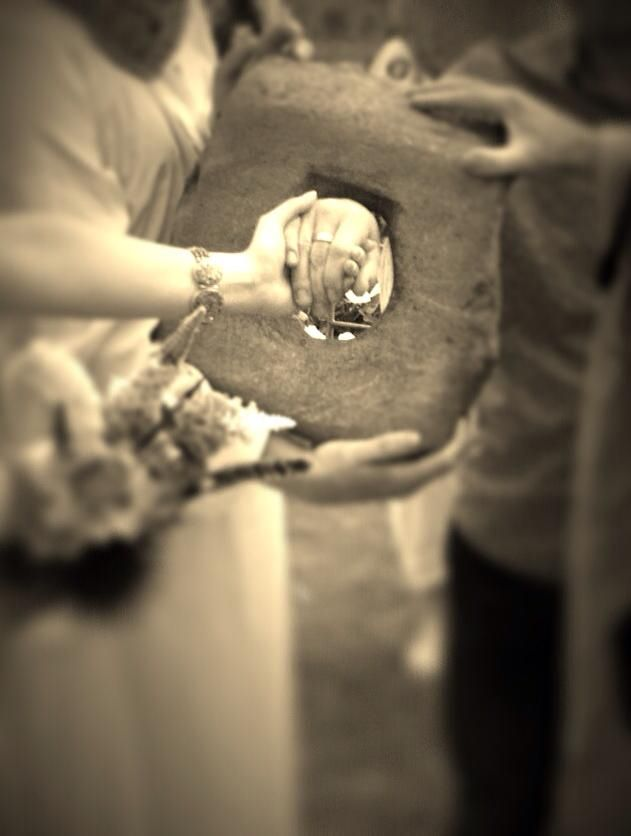 "Handfastening ceremony - the bride passes her hand through the eye of a love stone to be fastened to the wrist of the groom signifying eternal bonds and fidelity - Celtic spirituality - ancient rituals - nature - humanist - pagan traditions - ""blessings"""