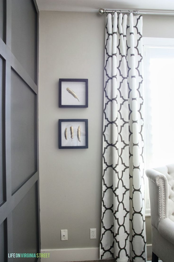 Obsessed with these curtains and the board and batten wall panels!