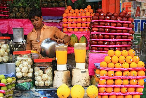 Fruit juice vendor in Kolkata, India. No lack of vitamins with this array of fruits to select of.