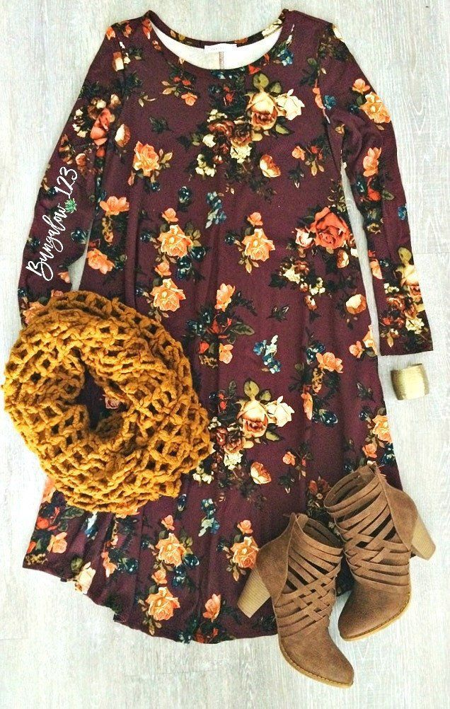 Gorgeous Floral Dress in Burgundy featuring a vintage floral motif throughout. Ultra-soft material with a longer length and fit and flare style. Two side pockets. Note the longer length on this dress