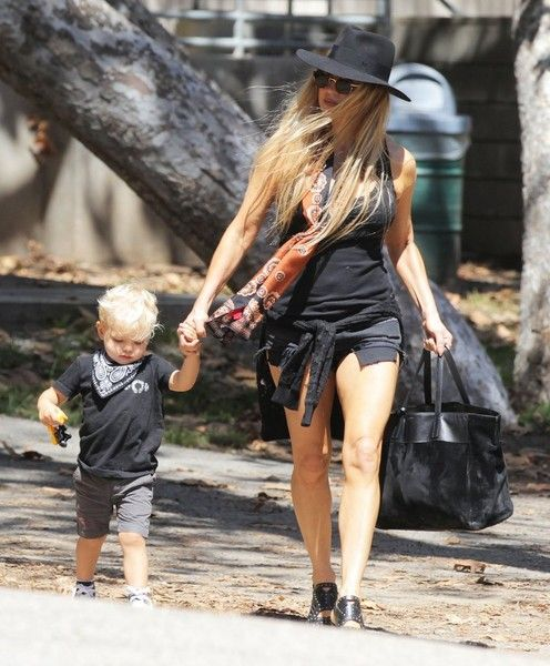 Pop star and proud mom Fergie is spotted leaving a park in Brentwood, California with her growing boy Axl on September 17, 2015. Fergie has been busy as of late working on her new album.