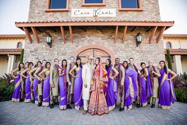 Purple sarees and sherwani. Bridesmaids.