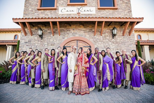 Purple sarees and sherwani. Bridesmaids.