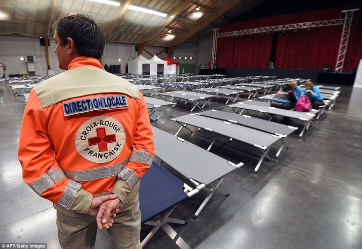 A French Red Cross staff member waits to greet the families of victims of the Germanwings ...