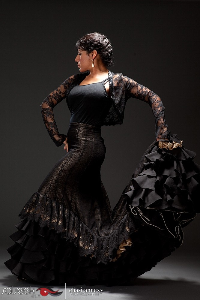 """This is a portrait of famed flamenco dancer Nelida Tirado by dance photographer Chasi Annexy.  What I love most about this photo is the intricate details of Neli's costume.  From the lace to the powerful ruffles of her skirt.  We wrote a story """"The Heart of Her Dance"""" featured on SALSEEK.com"""