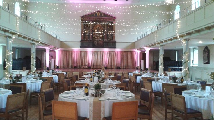 Fairy lights and subtle stage lighting for wedding breakfast at St George's Bristol