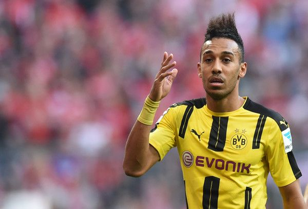 Dortmund's Gabonese striker Pierre-Emerick Aubameyang reacts during the German first division Bundesliga football match FC Bayern Munich v BVB Borussia Dortmund in Munich, southern Germany, on April 8, 2017. / AFP PHOTO / Christof STACHE / RESTRICTIONS: DURING MATCH TIME: DFL RULES TO LIMIT THE ONLINE USAGE TO 15 PICTURES PER MATCH AND FORBID IMAGE SEQUENCES TO SIMULATE VIDEO. == RESTRICTED TO EDITORIAL USE == FOR FURTHER QUERIES PLEASE CONTACT DFL DIRECTLY AT + 49 69 650050.