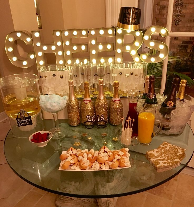 Champagne Bar!! (glittered champagne bottles, decorated glasses, champagne Jell-O shots, and champagne cocktail. Cotton candy, rock candy, OJ and cranberry mixers)