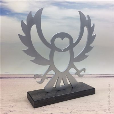 Owl sculpture: aluminum with maple base. Artist: Shirley Lloyd-Davies & Kelly Crosson/Dundee Designs Inc.