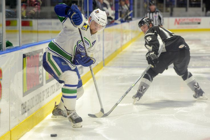 Tina Russell / Observer-Dispatch From left, Utica Comets player Brandon DeFazio takes control over the puck as San Antonio Rampage player Brett Olson defends during AHL hockey at the Utica Memorial Auditorium Thursday, Jan. 1, 2015.  Read more: http://www.uticaod.com/apps/pbcs.dll/gallery?Site=NY&Date=20150101&Category=PHOTOGALLERY&ArtNo=101009998&Ref=PH&taxoid=&refresh=true#ixzz3NddvD1Mb