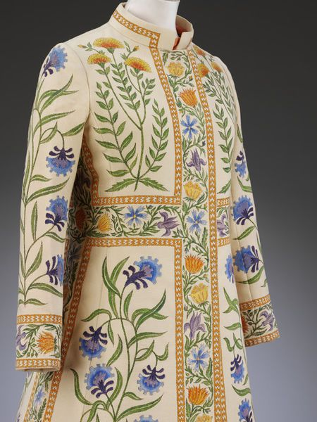 "This hand-painted coat was designed by Richard Cawley when he was an assistant designer at the London fashion house Bellville Sassoon. It was presented as part of the 1970 Winter Couture collection, which was inspired by Indian art and culture. This coat was named ""Rajputana"" after a former group of princely states in north-western India and featured in colour in the November 1970 issue of Vogue magazine."