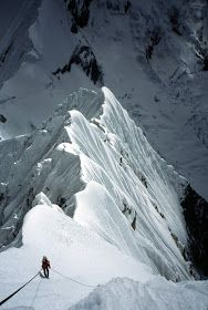 Mark Price descending the North Ridge of Siula Grande, Cordillera Huayhuash, Peru after our first ascent of Avoiding the Touch on Siula's West Face, 1999.