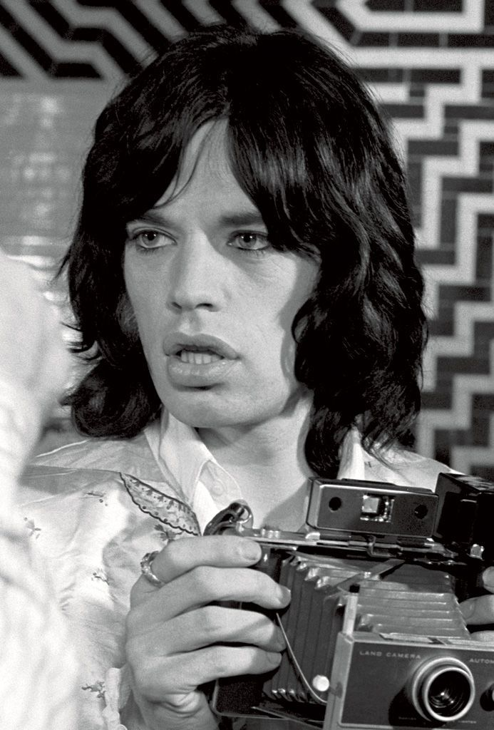 Mick Jagger with a Polaroid Image by Baron Wolman
