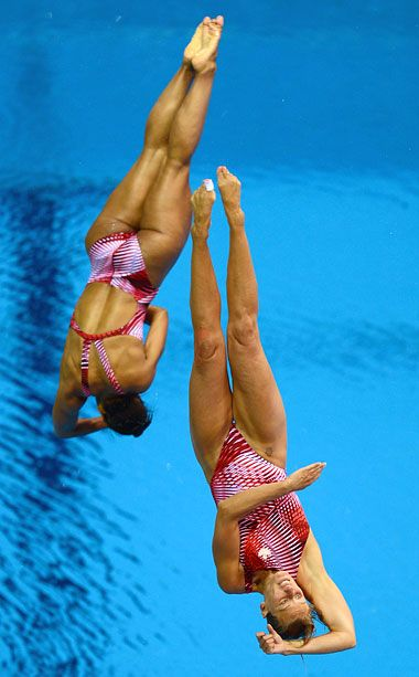 BEST: Canada Women's Synchronized Diving Why It Worked: Emilie Heymans and Jennifer Abel scored the bronze medal for Canada in figure-flattering suits (not that their perfectly toned swimmer's bodies need much help). No word yet whether Heymans, an aspiring swimwear designer, had a hand in the duo's stylish maillots.