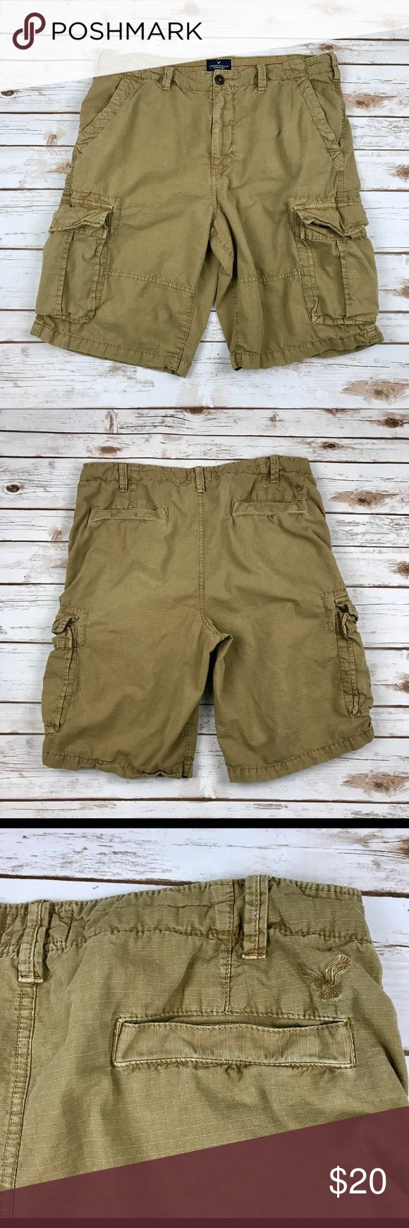 """American Eagle Longboard Cargo ShortsMen's Sz 38 American Eagle """"Longboard"""" Cargo Shorts  Men's Size 38  Khaki/Tan/Coyote 6 Pocket Casual style Materials: 100% cotton Gently pre-owned. Light signs of wear.   Actual measurements taken laying flat: waist- 19"""" rise- 13.5"""" inseam- 11"""" leg opening- 12""""   Location- B16 American Eagle Outfitters Shorts Cargo"""