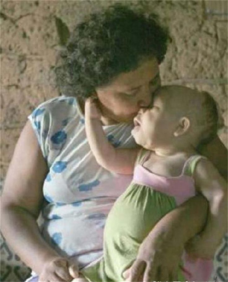 """Asked by a TV presenter from Record News what it's like to be the mother of a child that's eternally a baby, Doura replied, """"Being mother of a child like her… I think is a gift that God gave us."""""""