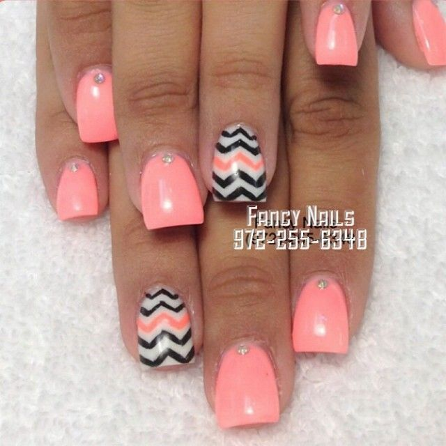 Neon coral and chevron nails