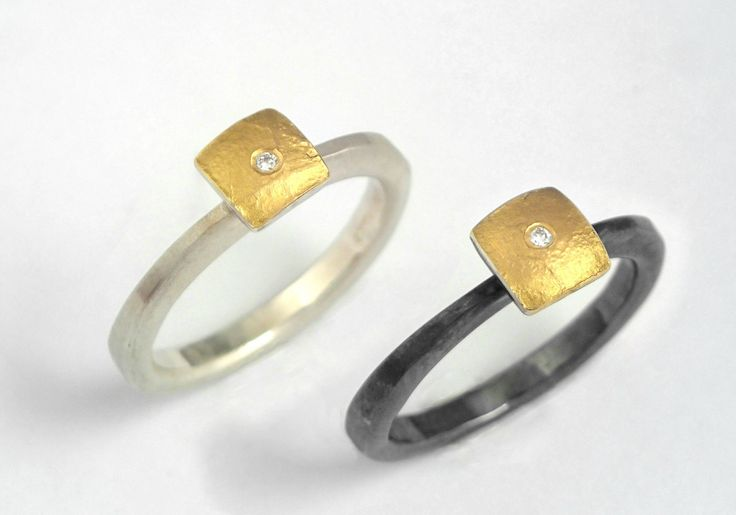 Minimal square gold and solver ring decorated with a diamond, a rough surface…