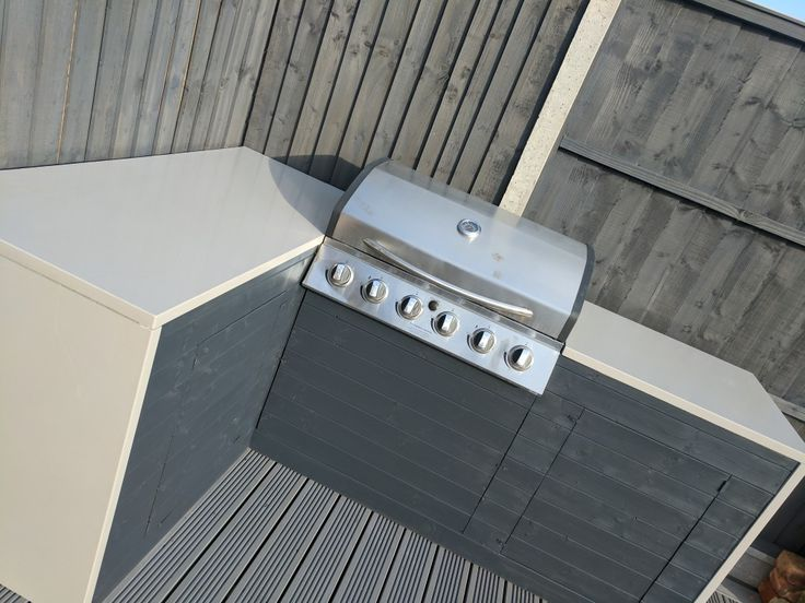 Finally finished the outdoor kitchen area. 6 burner BBQ, beer fridge and silestone worktop..