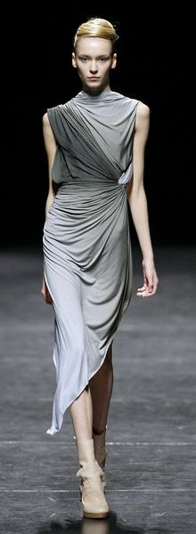Haider Ackerman Spring 2009. This draped dress by Ackerman evokes the soft lines and curves that we associate with femininity.