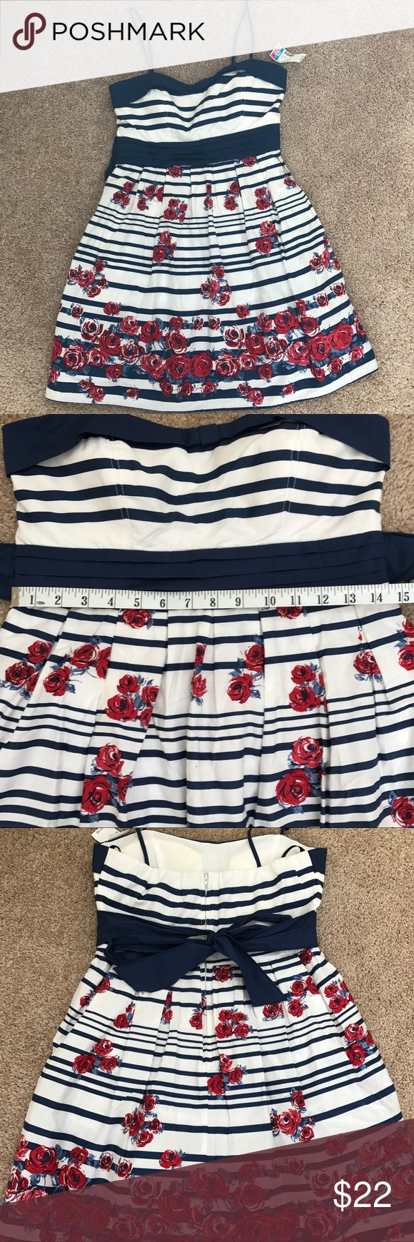 Nautical Rose Party dress Adorable spaghetti strap blue and white dress with roses. Bow tie around the back along with zipper. New with tags! Would be super cute for a wedding guest dress, or a less formal homecoming dress. Juniors size 9 City Triangles Dresses
