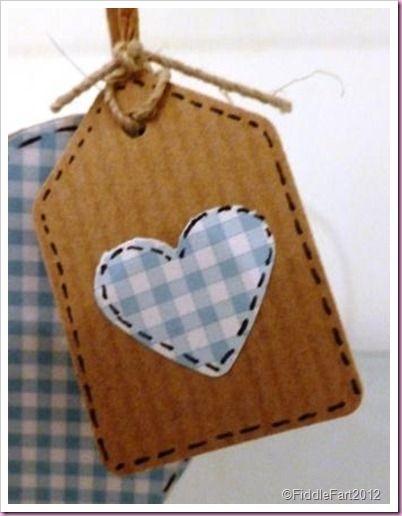 small gingham heart tag:   or enlarge for wall art..... use card, felt stuck to card....  or mount it on a stretched canvas.   A set of little ones would be cute.... or hang them like bunting.  (Ok, I'll try to switch off the ideas now - but I'll wager you can think of a few ideas already)!