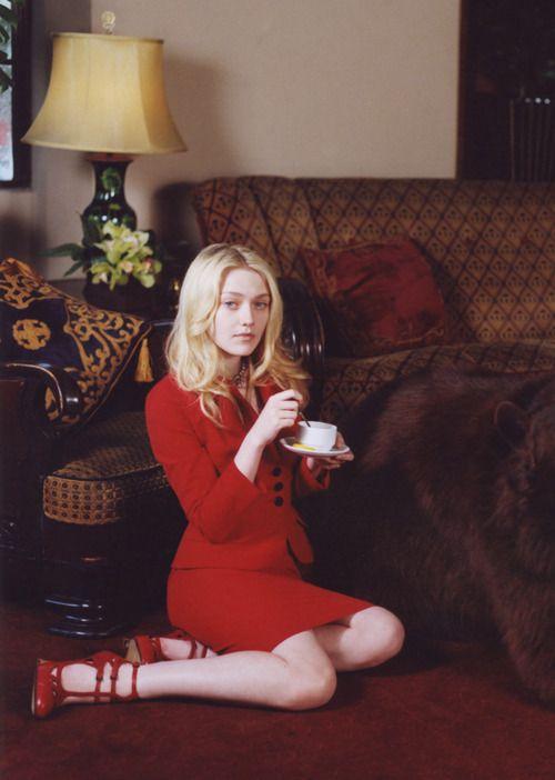 Dakota Fanning enjoying her tea, head to toe in Dior