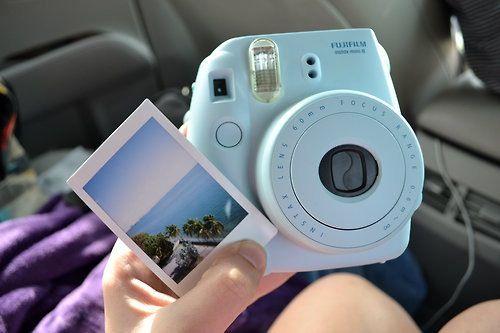 Blue Fuji film in stand poloroid camera