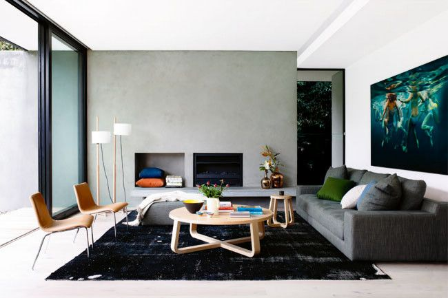 Living room Homeowner Romy's favourite room showcases her home's contemporary look, furnished with simple yet standout pieces like Jardan's 'Empire' modular sofa and a 'Jade' coffee table from Zuster.  Artwork: Convergence by Martine Emdur.