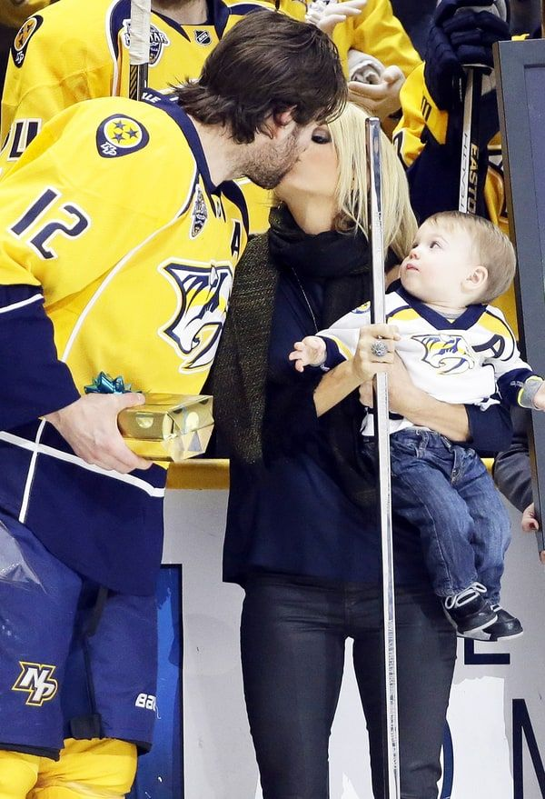 Carrie Underwood, Mike Fisher Kiss While Isaiah Looks On - Us Weekly March 22, 2016