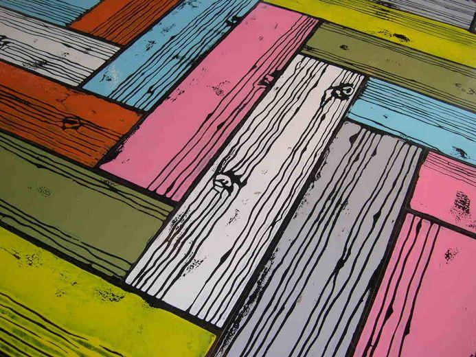 o trabalho do inglês Richard Woods, que cria pisos utilizando técnicas de trompe l'oeil e pintura a mão. Para isso ele utiliza tábuas de pinus, que recebem padronagens recriando os próprios veios da madeira natural e depois são pintadas com cores super alegres, criando um resultado surpreendente.