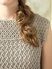 A sleeveless tee worked with welt details and easy eyelet lace ribbing. This piece is worked from the bottom up in two pieces and seamed.