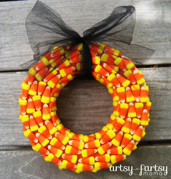 "Candy Corn Wreath  21oz bag Candy Corn, Wreath form 12"" from Dollar Tree, Acrylic paint orange or black to paint wreath"